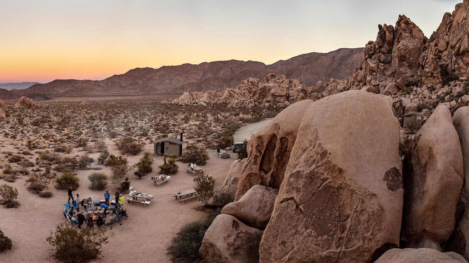 Students camping out in Joshua tree at sunset with Summit Adventure
