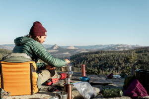 Student cooking breakfast in the backcountry in Yosemite Wilderness