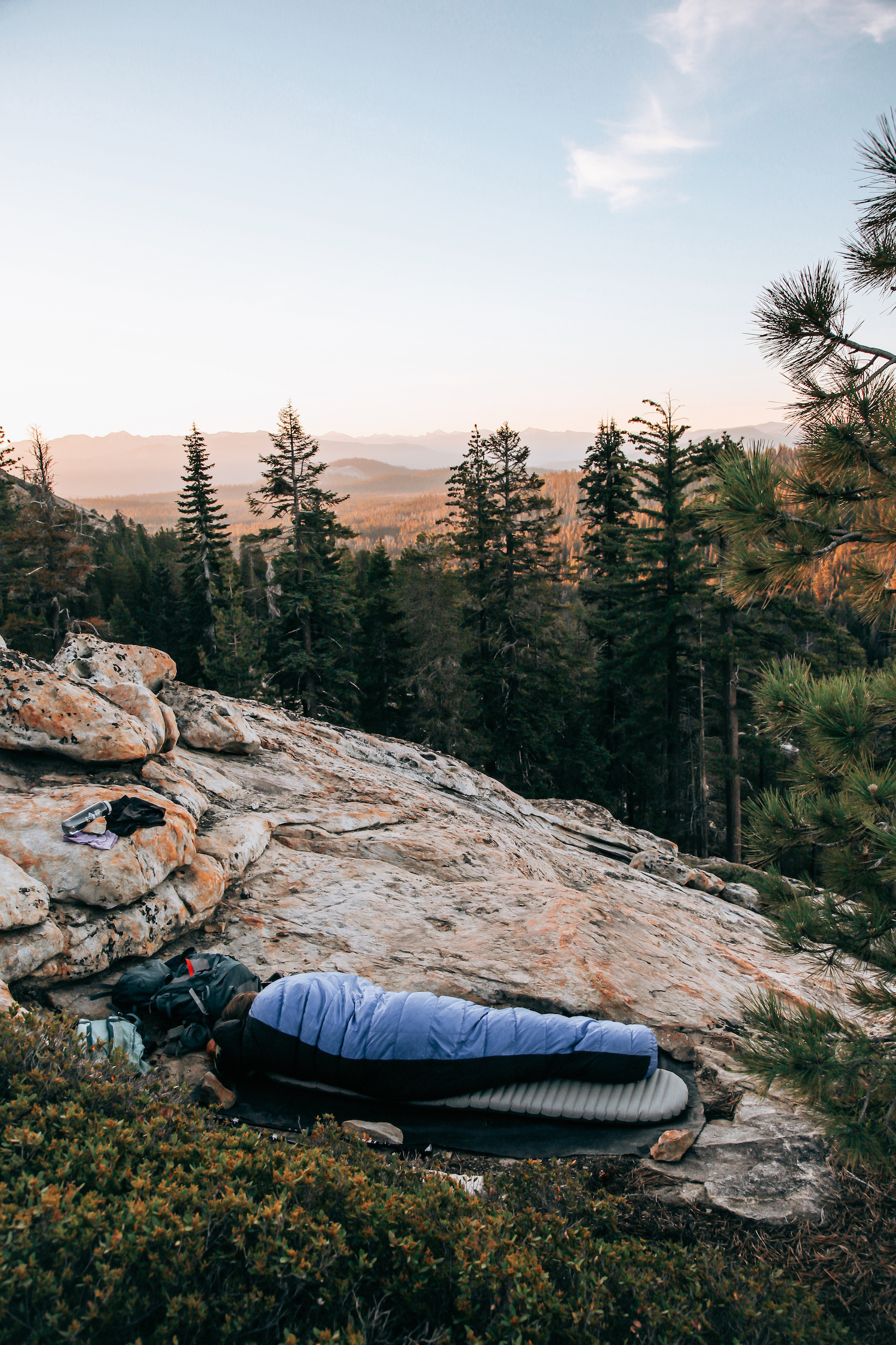 Sleeping under the stars on a ledge in the wilderness