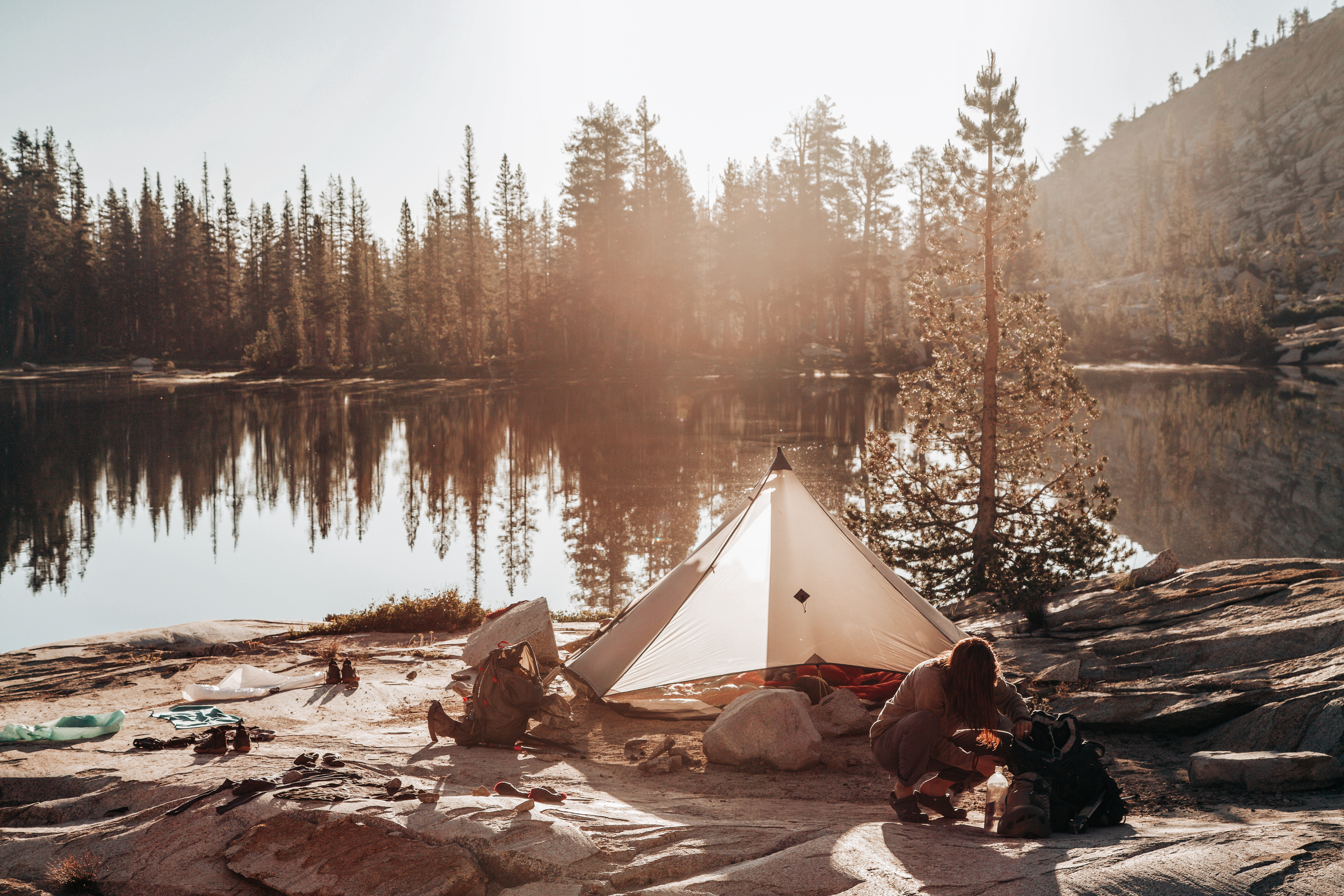 Tent by an alpine lake in Yosemite Wilderness