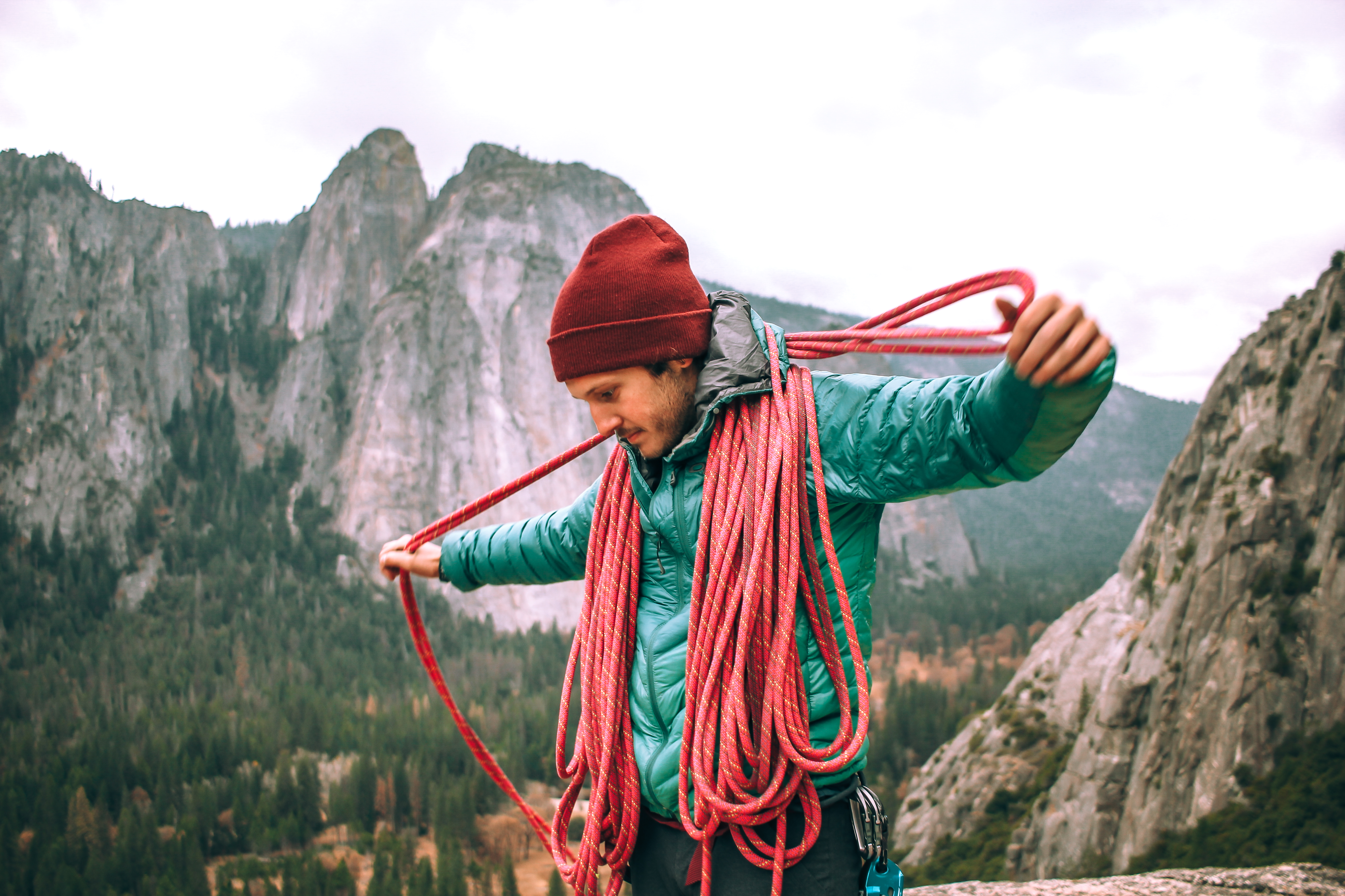Man coiling rope in Yosemite National Park rock climbing