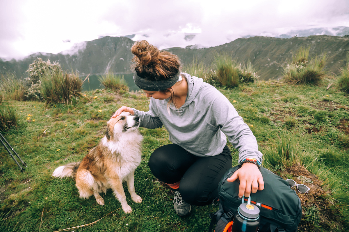 girl with a dog in Quilatoa in Ecuador